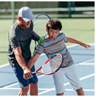 TAG Tennis Elite-USTA.com Page_ Coach_PTM_Male Coach and Jr Player practiciing voley